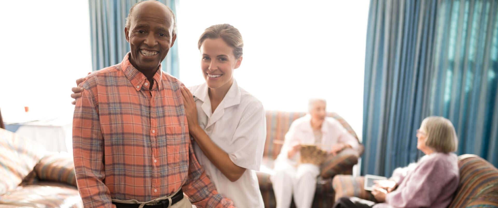 a senior man and a caregiver
