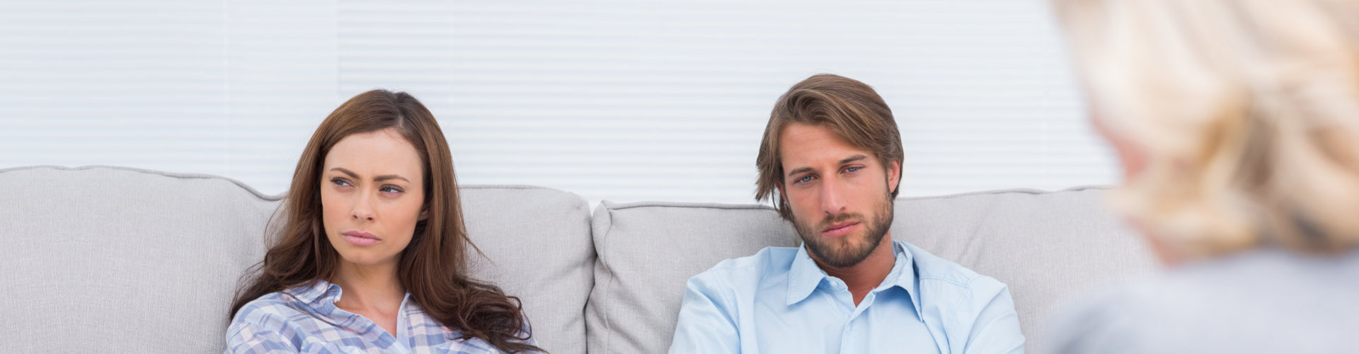 young couple listening to therapist